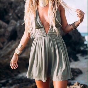 Green shirt dress with plunging neck line